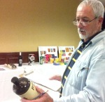 Photographer David Fairchild gives a label a close look during the judging of Package Design for Mobius Awards